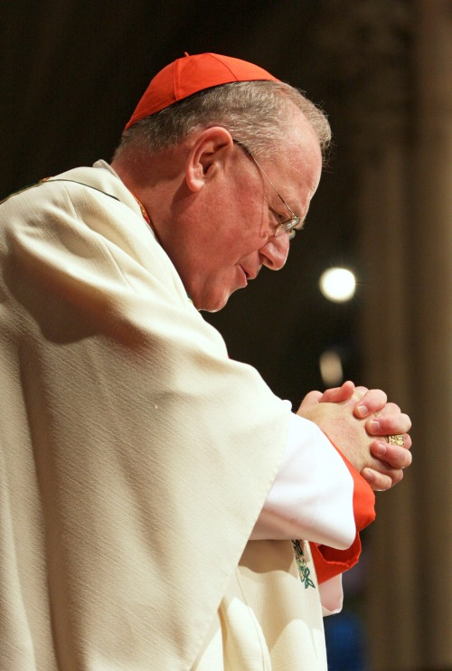 CARDINAL DOLAN PRAYS DURING MASS EARLIER THIS YEAR